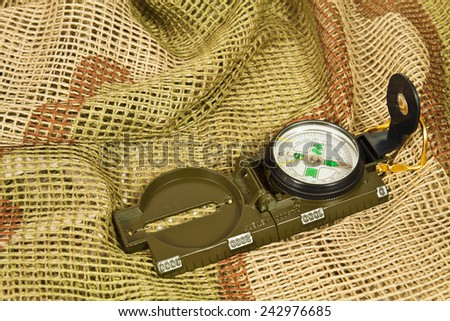 Classic Army metal compass for tactical exercises - stock photo