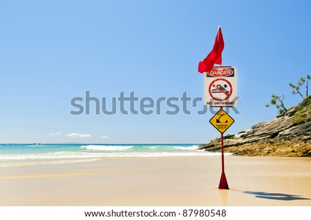 Classic Australian beach with warning flag from surf life savers - stock photo