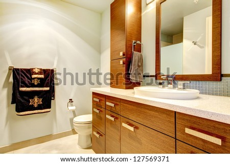 Classic bathroom interior with modern cabinets. - stock photo