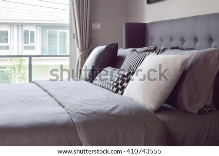 Classic bedroom interior with pillows next to the window