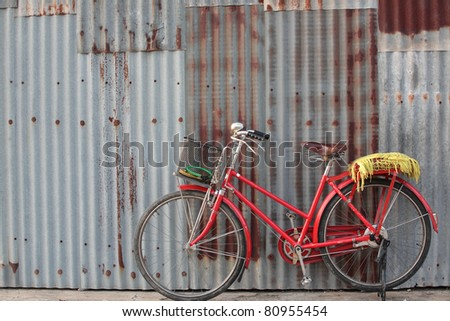 classic bicycle at old metal fence - stock photo