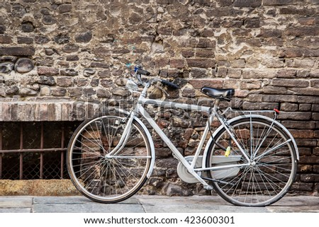 Classic bicycle standing on the street in Italy. - stock photo