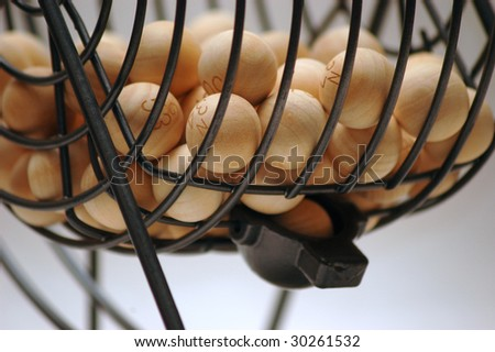 Classic bingo spinner with wooden balls close-up - stock photo