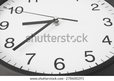 Classic black and white clock close up - stock photo