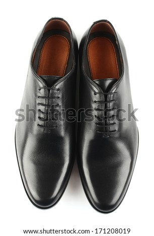 Classic black leather mens shoes with laces isolated on white background top view - stock photo
