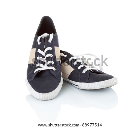 Classic black sneakers isolated on white background - stock photo