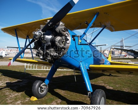 classic blue biplane - stock photo