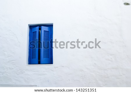 Classic Blue windows details at Serifos island, Greece