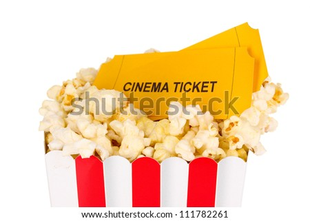classic box of popcorn and cinema tickets isolated on white - stock photo