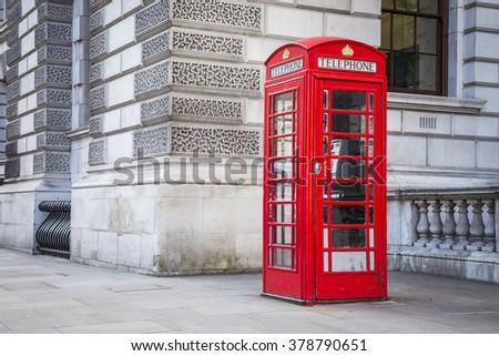 Classic British red telephone box in London, UK