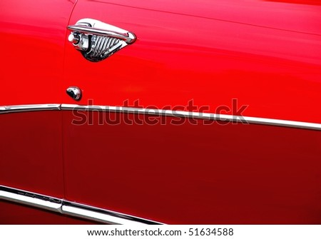 Classic candy apple red vintage car side - stock photo