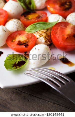 Classic caprese salad closeup on the plate - stock photo