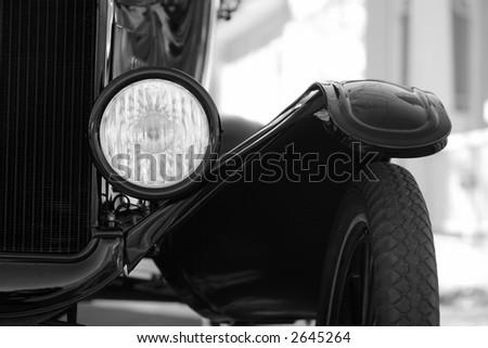 Classic car headlight closeup - stock photo
