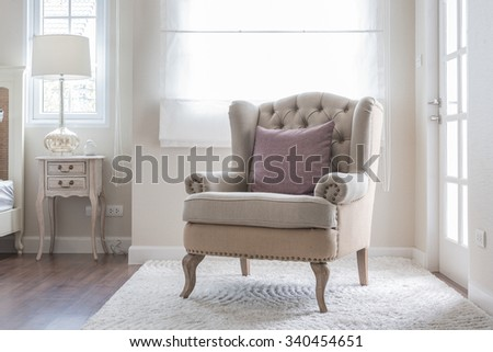 classic chair on carpet with pillow in bedroom - stock photo
