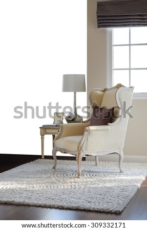classic chair with brown pillow on carpet in vintage style interior isolate on white background - stock photo
