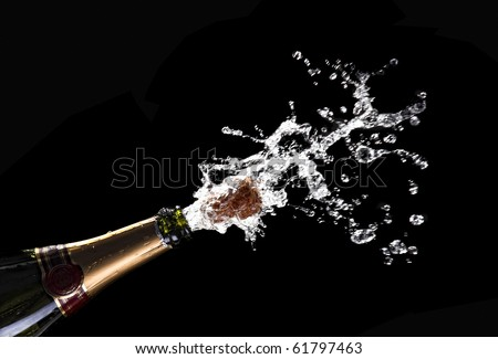 classic champagne bottle with popping cork background - stock photo