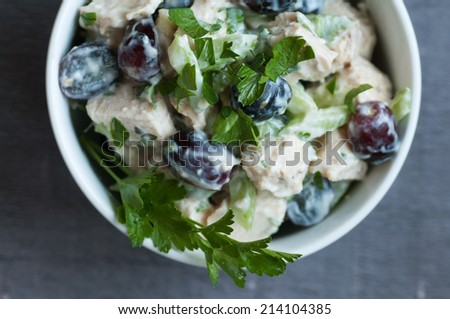 Classic chicken salad with grapes celery and herbs - stock photo