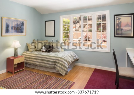 Classic Children bedroom / kids room with light colorful decoration, rug, bed and desk. - stock photo
