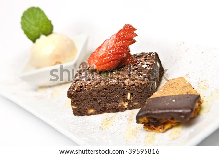 Classic Chocolate brownie served with strawberry and ice cream - stock photo