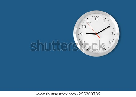 classic clock on blue background with copy-space - stock photo