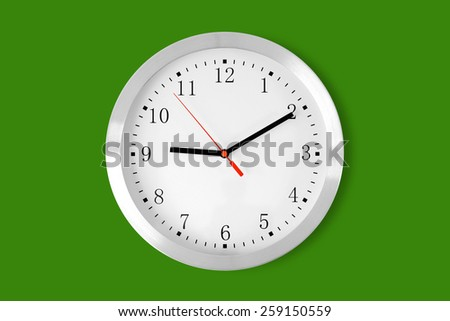 classic clock on green background - stock photo