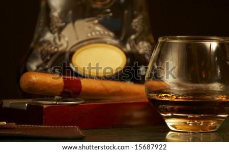 classic cognac bottle, cigar - stock photo