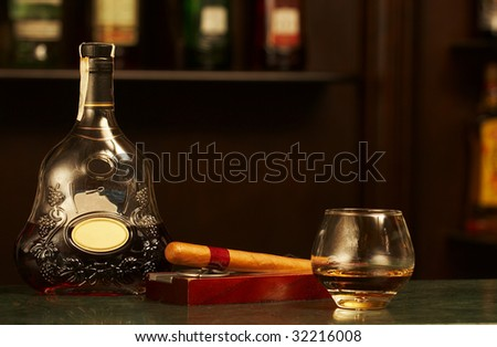 classic cognac bottle, cigar - stock photo