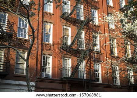 Classic colorful old apartment buildings in, New York City - stock photo