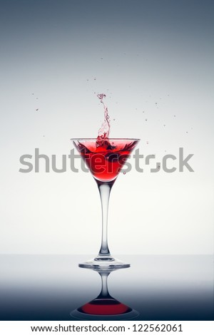 classic contemporary cocktail with display on the mirror - stock photo