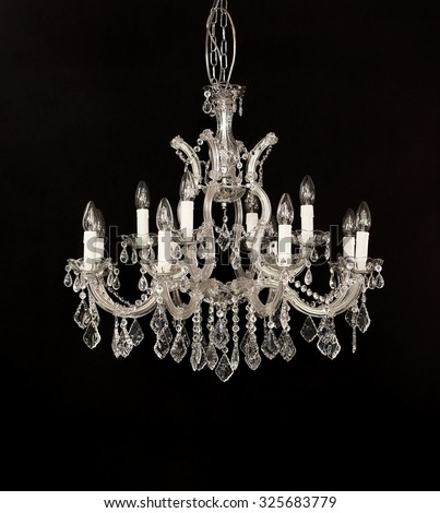 Classic Crystal Chandelier Isolated on Black Background - stock photo