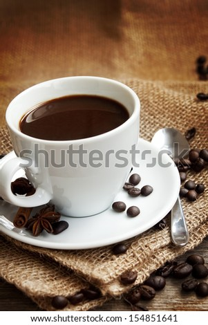 classic cup of coffee with coffee beans on old vintage background