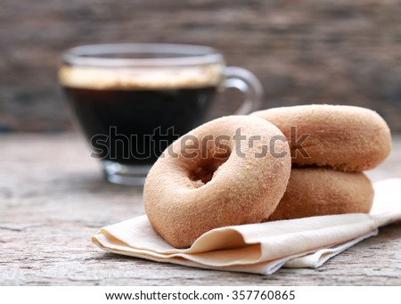 classic donut and coffee on wood background. - stock photo