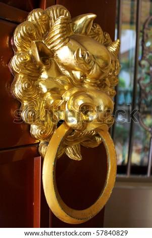 Classic dragon head Door Knocker - stock photo