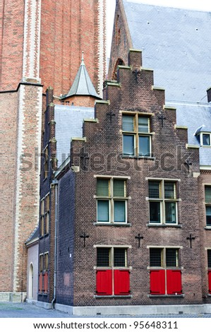 Classic dutch building with red shutters