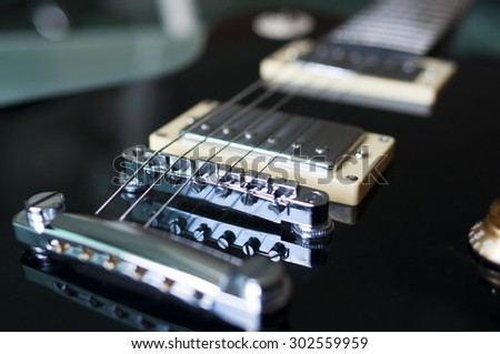 Classic electric guitar with string detail