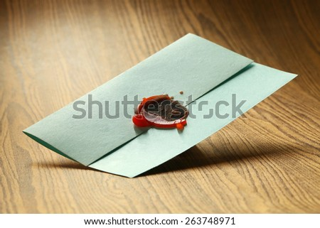Classic envelope seal wax stamped represent the letter security concept related idea. Super macro shot and intention focus at the wax sealed. - stock photo