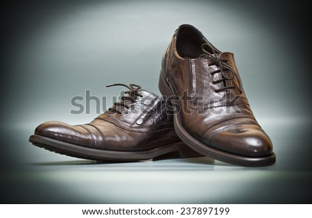 classic expensive leather shoes on abstract background