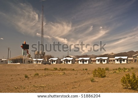 Classic Fifties Motor Hotel along old Route 66 that is now abandoned in Amboy, California - a modern ghost town in California's Mojave Desert. - stock photo