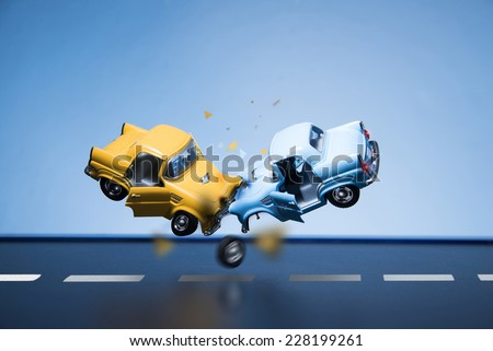 Classic fifties scale model toy cars accident on the road. - stock photo