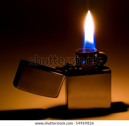 Classic Flip Top Lighter with Flame and Shadow - stock photo