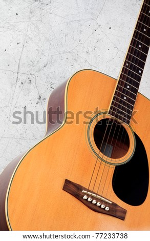 Classic folk guitar on grunge wall