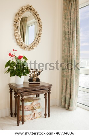 Classic furniture in room overlooking river - stock photo
