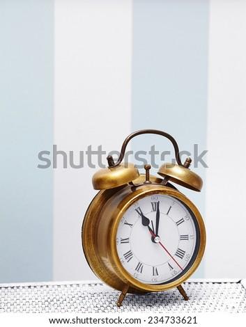 classic gold clock  watch in bright colorful retro interior  - stock photo