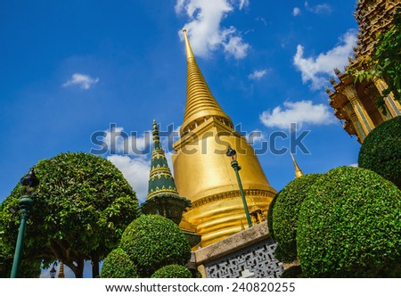 Classic golden buddhist chedi in Great Palace temple in Bangkok, Thailand - stock photo