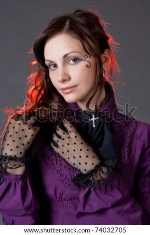 Classic gothic girl portrait, studio shot over gray background - stock photo