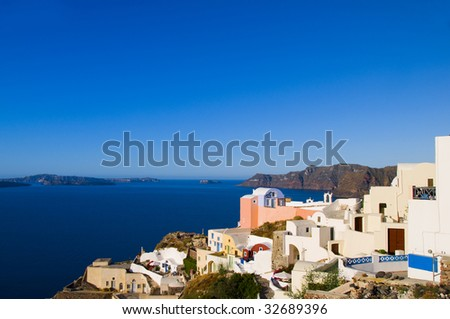 classic greek island architecture with view of aegean mediterranean sea and the caldera volcanic island of oia santorini greece cyclades islands - stock photo