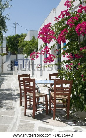 classic greek taverna furniture restaurant cafe on the stone painted street greece islands with flowers