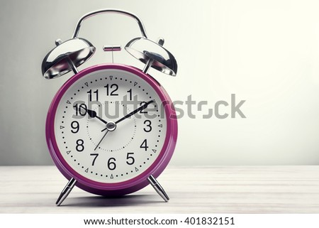 classic green alarm clock morning wake-up time - stock photo