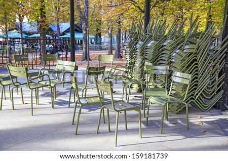 Classic green iron outdoor chairs of the Luxembourg garden piled in one of the garden's pavilions, Paris, France - stock photo