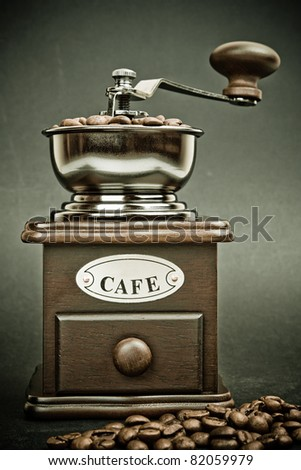 Classic grinder with a coffee beans with a retro effect. - stock photo